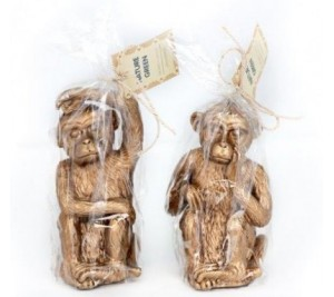 A mix of two on trend stylish gold monkey candles