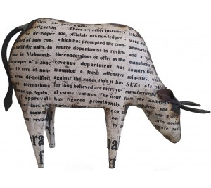 Fabulous metal cow sculpture with painted newsprint detail